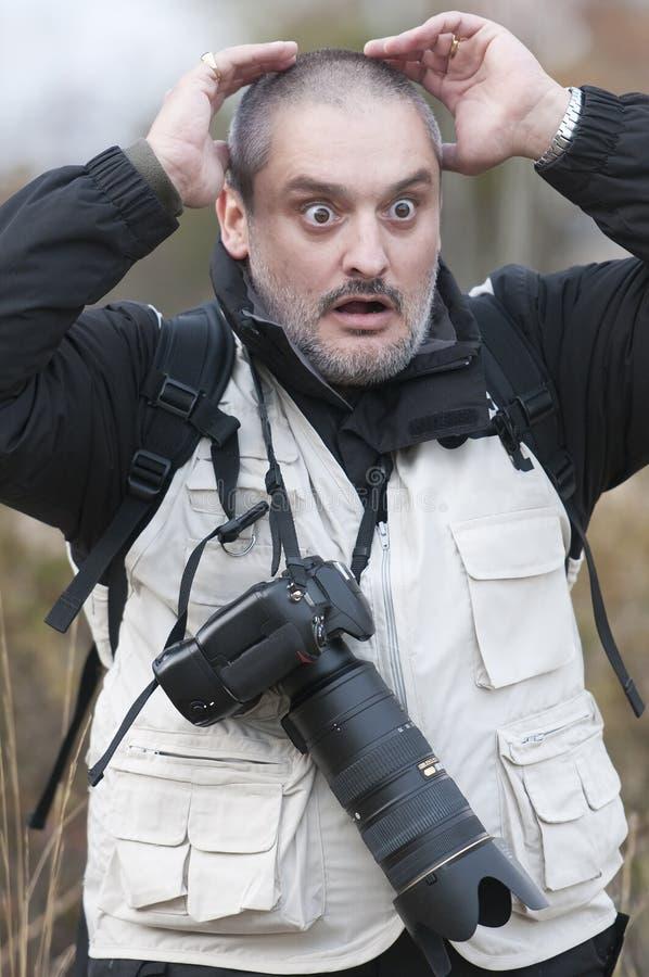 Terrified photographer. royalty free stock photo