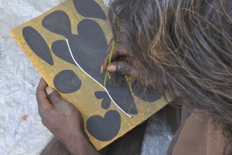 Território do Norte aborígene Austrália da pintura do ponto do artista fotografia de stock royalty free