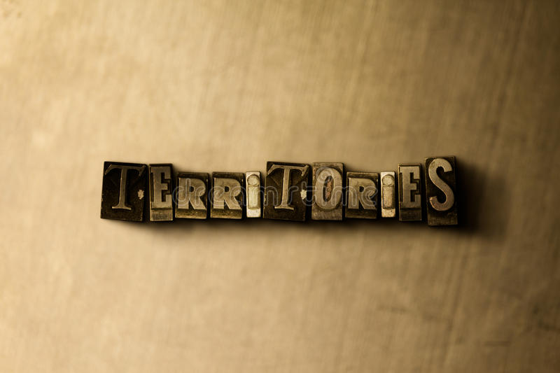 TERRITORIES - close-up of grungy vintage typeset word on metal backdrop vector illustration