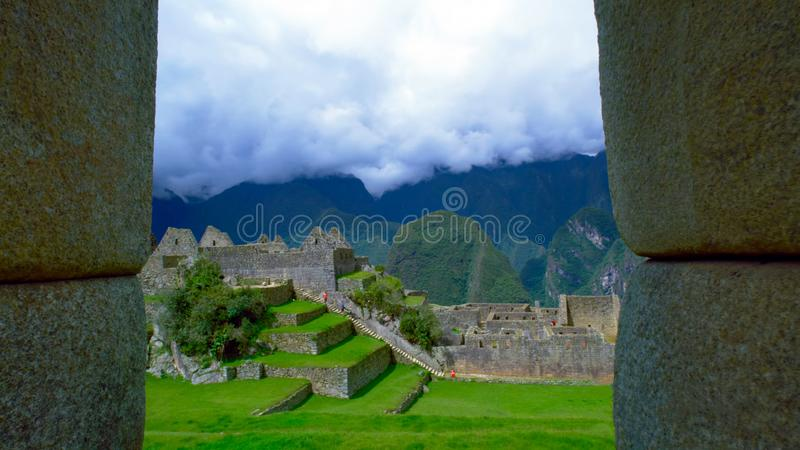 On the territory of the historic complex Machu Picchu stone steps. On the territory of the historic Machu Picchu complex stone steps covered with green grass royalty free stock photography