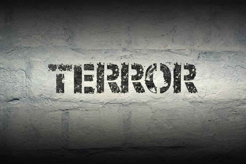 Terror word gr. Terror stencil print on the grunge white brick wall stock photography