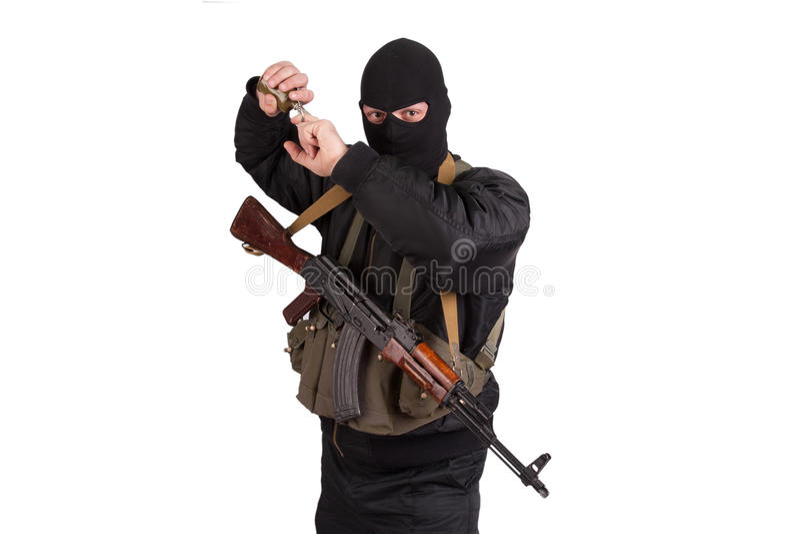 Terrorist in black uniform and mask stock image
