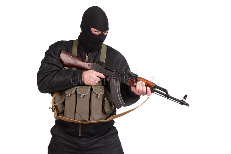 Terrorist in black uniform and mask with kalashnikov isolated. On white stock photos