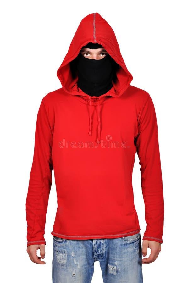 Terrorist in der Maske stockbild