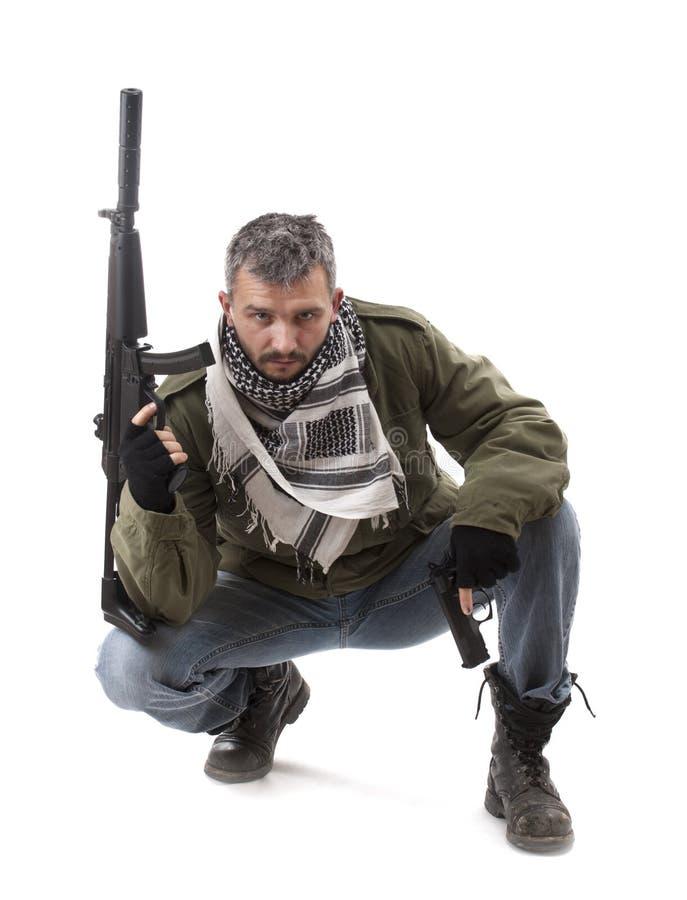 Terrorist with gun royalty free stock photo