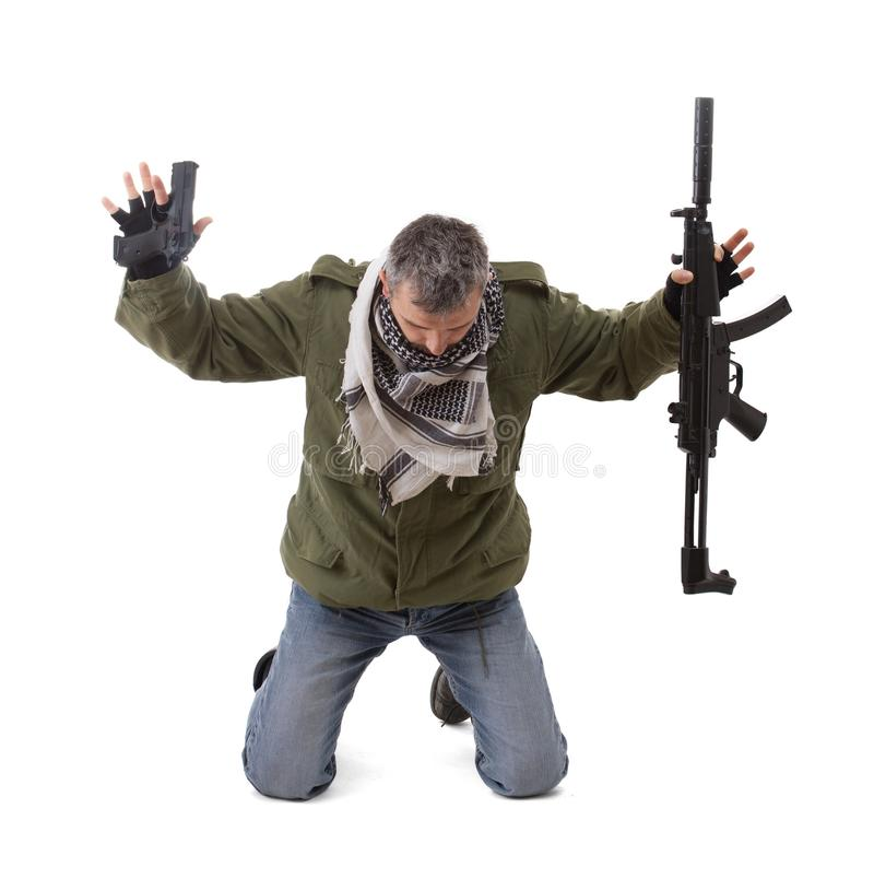 Terrorist with hands up royalty free stock photography