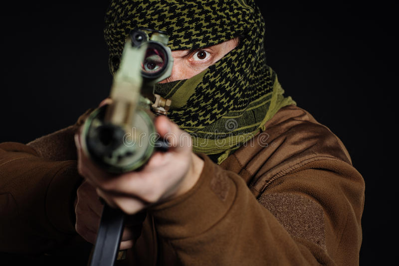 Terrorist with his rifle. Concept about terrorism stock images
