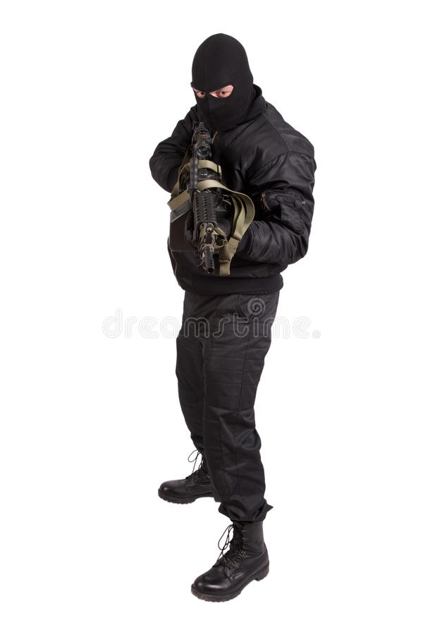 Terrorist with machine gun isolated royalty free stock photography