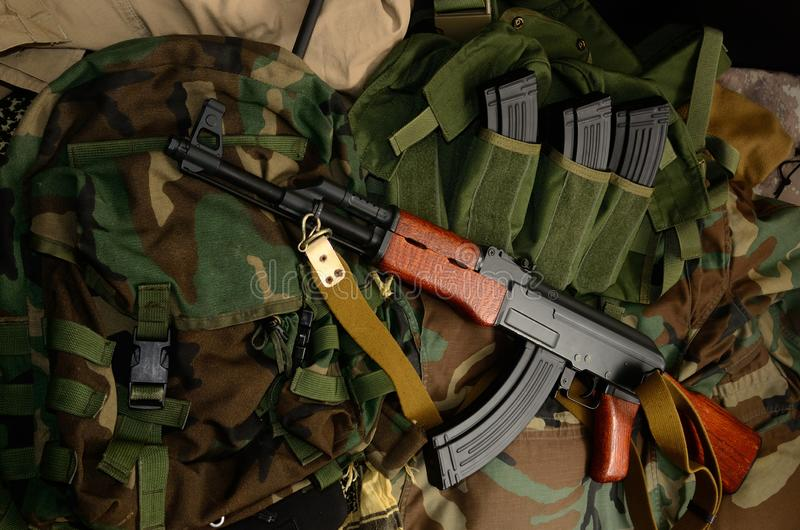 Terrorist Weapons with tactical chest rigs and backpack stock photography