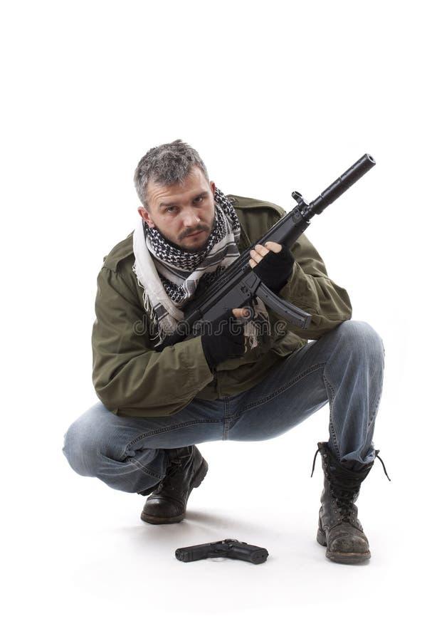 Terrorista com injetor imagem de stock