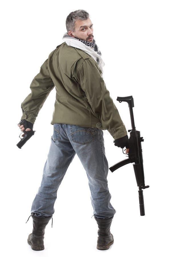 Terrorista com rifle imagem de stock
