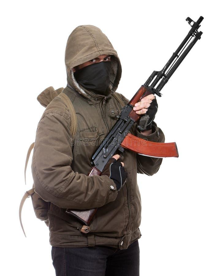 Terrorista con el arma imágenes de archivo libres de regalías
