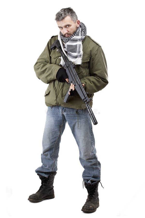 Terrorista con el rifle imagen de archivo libre de regalías