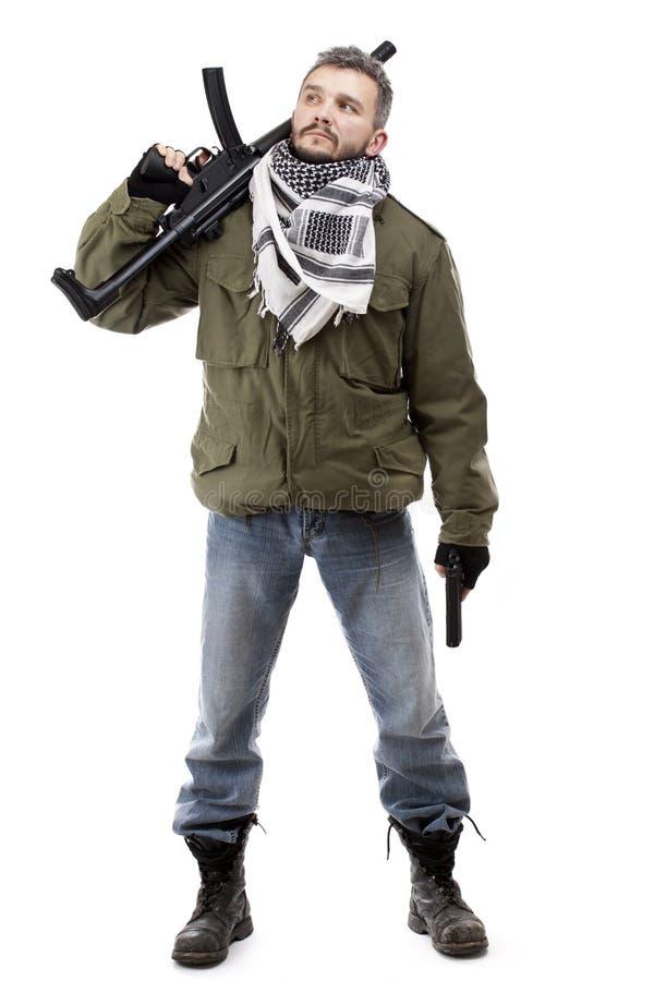 Terrorista con el rifle imágenes de archivo libres de regalías