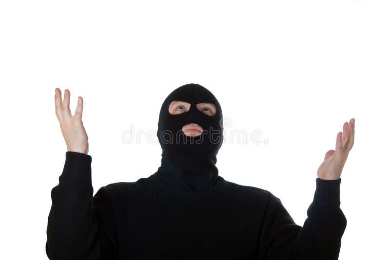 Terrorista Praying isolado no branco. imagem de stock
