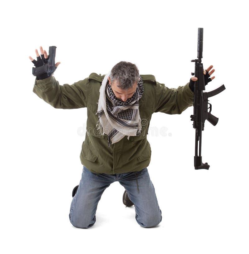 Terroriste avec des mains vers le haut photographie stock libre de droits