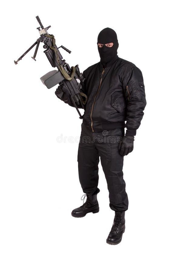 Terroriste avec la mitrailleuse photo stock