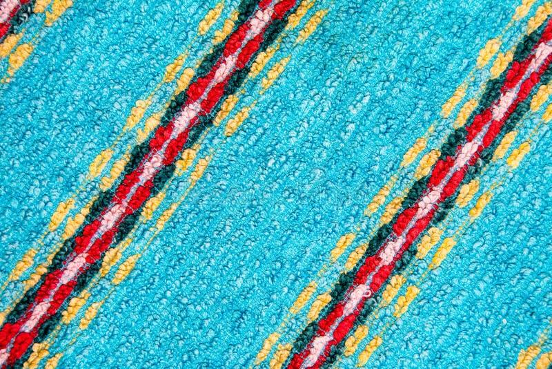 Terry blauwe achtergrond met gekleurde stroken van doek stock afbeelding