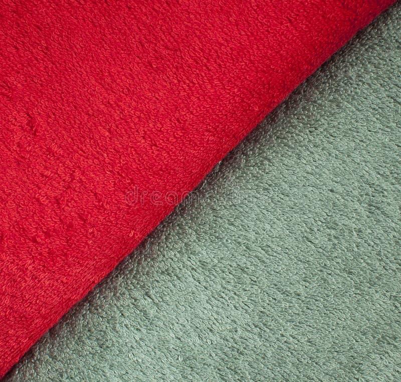 Terry ręcznik czerwień i oliwny kolor, tekstura ręczniki obrazy royalty free