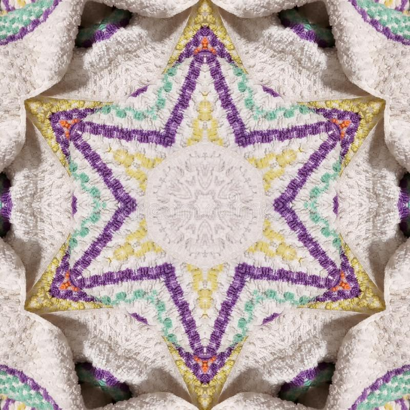 Terry towel origami. Embroidery Six-pointed star of David. Jewish symbolism. royalty free stock photo