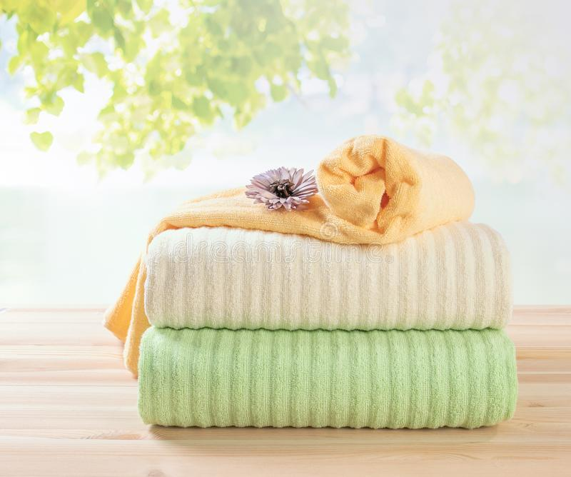 Terry towels stack, differnt colors towels in stack stock image