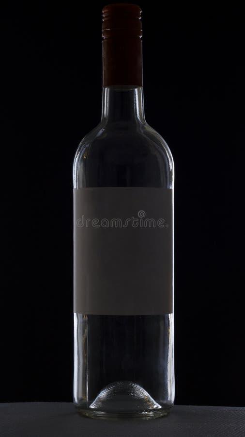 Terug aangestoken wijnfles stock afbeelding