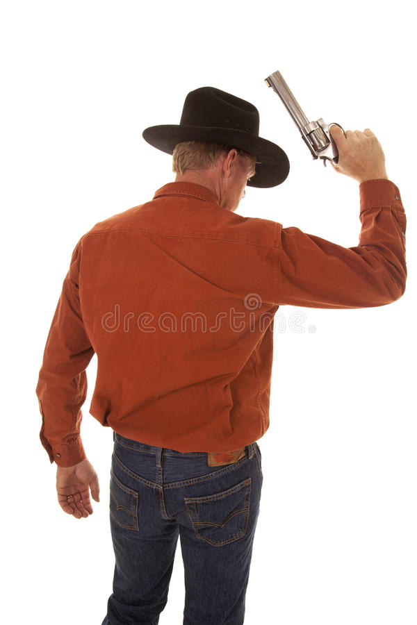 Terug van een cowboy die een pistool steunen stock afbeeldingen