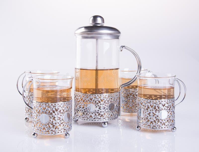 teservis eller teservis med te på bakgrund royaltyfri fotografi