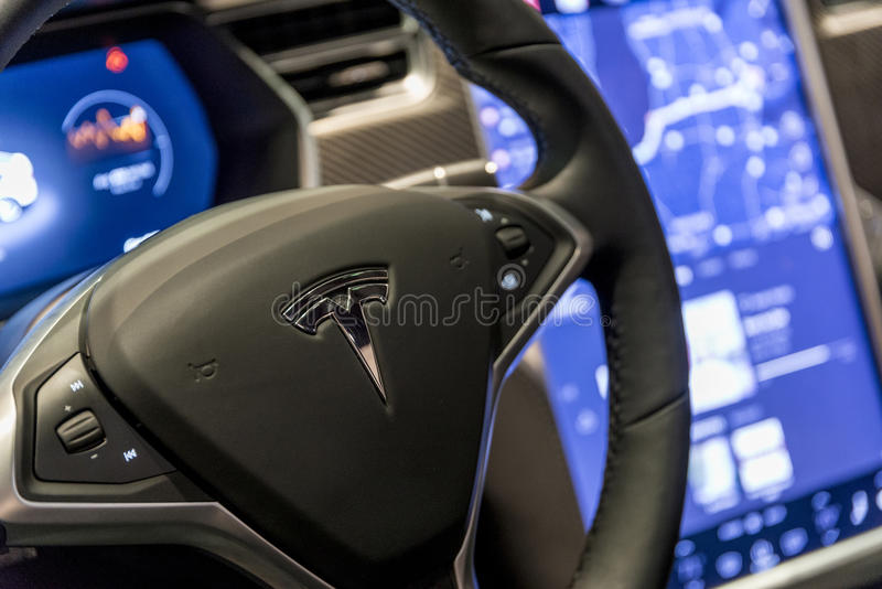Tesla car steering wheel stock photos