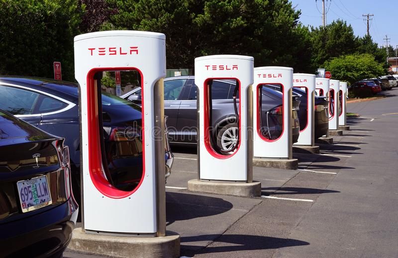 Tesla charging stations are always in use. The NEMA 14-50 charger for Tesla electric cars is  similar to the type used by your clothes dryer or other appliances stock photos