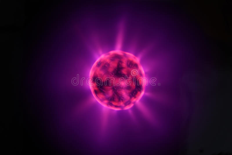 Tesla Coil with Lightnings. High-Voltage Tesla Coil with Lightnings - looks like an Atom, a Synapse, a Cell/Loculus, a Black Hole, etc stock images