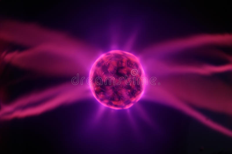 Tesla Coil with Lightnings. High-Voltage Tesla Coil with Lightnings - looks like an Atom, a Synapse, a Cell/Loculus, a Black Hole, etc royalty free stock photo