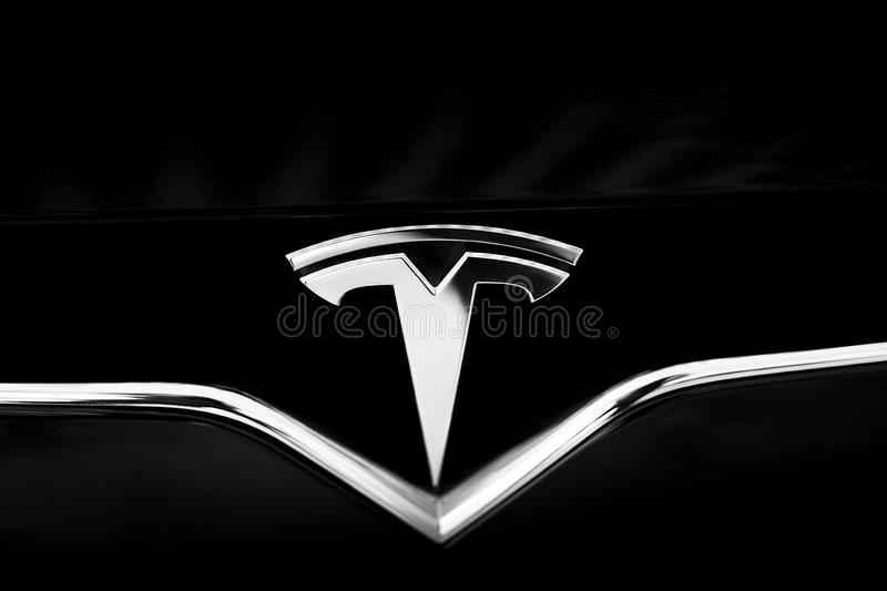 Tesla Emblem on Black Car. Close-Up Silver Logo stock photos