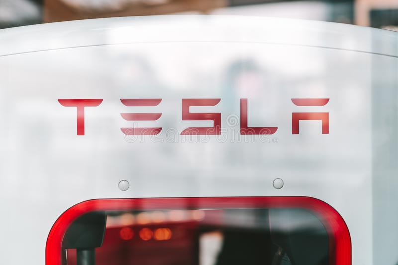 Tesla logo in car store in Milan, Italy royalty free stock photography