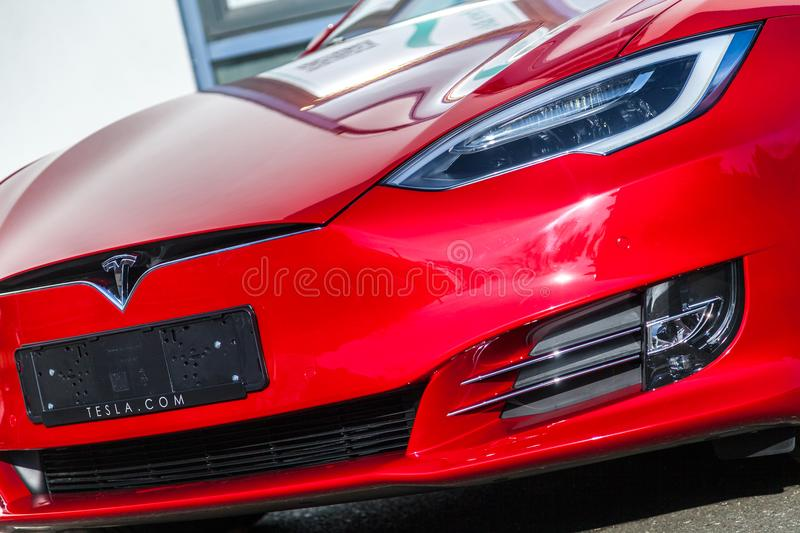Tesla logo on a Tesla car stock images
