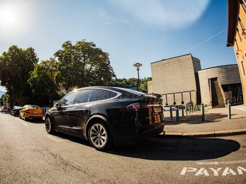 Tesla Model X SUV car parked street wide angel lens stock images