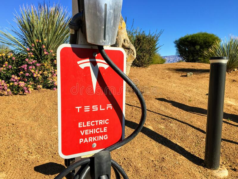 Tesla parking stall and recharging station in the desert of Palm Springs, California, United States. Palm Springs, California, United States - February 1st stock image