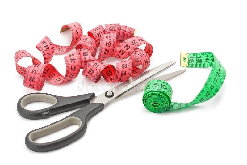Tesouras e fita de medição fotografia de stock