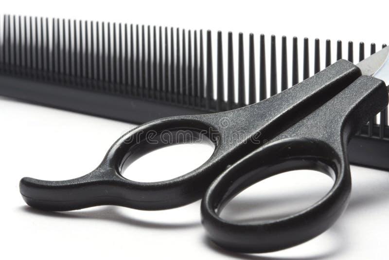Tesouras e hairbrush fotografia de stock