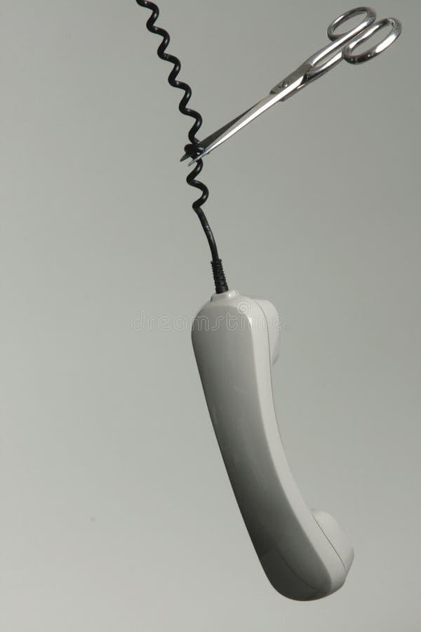 Tesouras que cortam o cabo de telefone