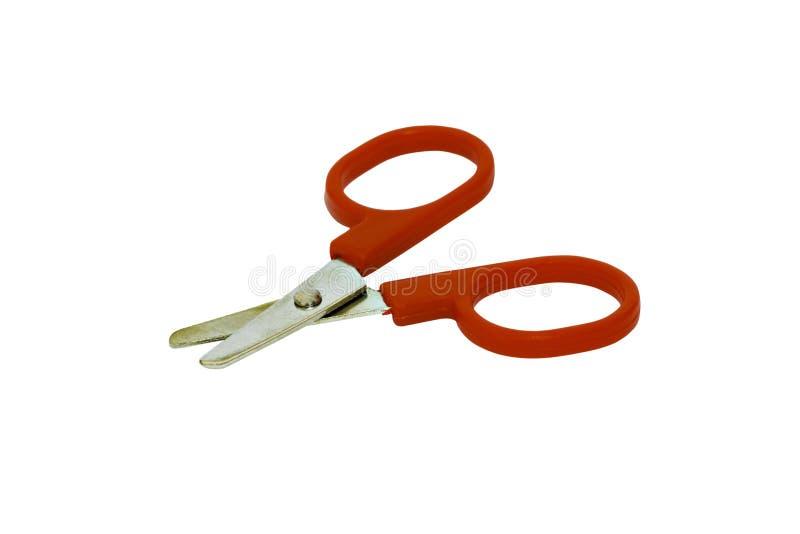 Tesouras usadas com o punho vermelho isolado no fundo branco foto de stock