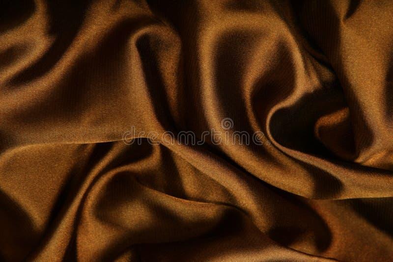 Tessile liscia del Brown fotografie stock