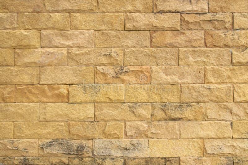 Tessitura di parete gialla di arenaria per lo sfondo fotografie stock