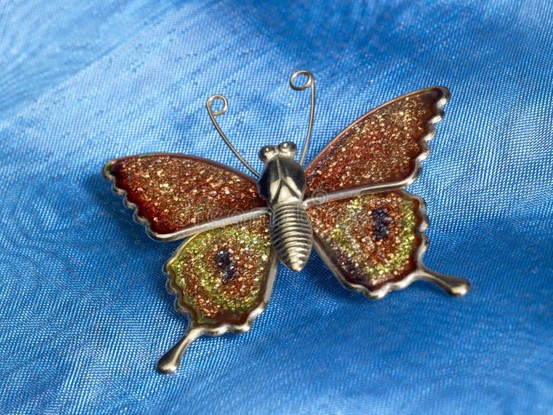 Tessuti del blu del ob del ninnolo della farfalla fotografie stock