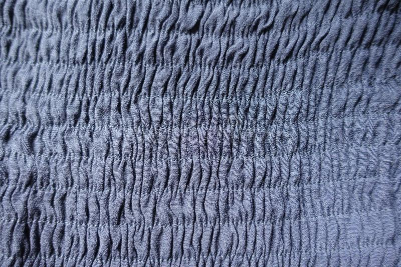 Tessuto blu arricciato con le cuciture orizzontali fotografie stock libere da diritti