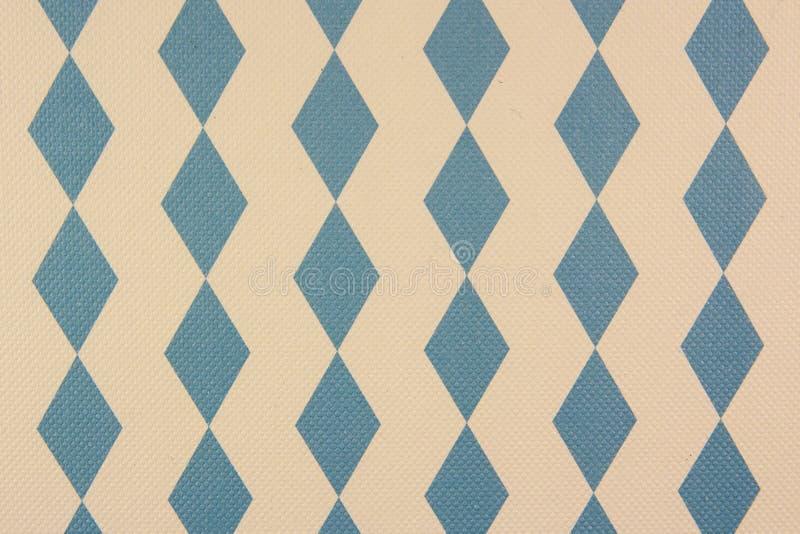 Tessuto con un modello dei rombi blu-chiaro sui precedenti bianchi fotografia stock