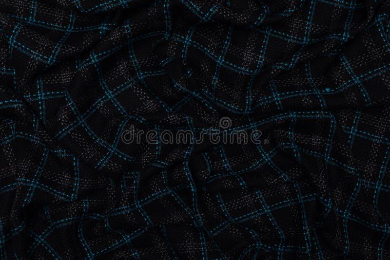 Tessuto controllato blu scuro con il fondo di struttura del tessuto immagini stock