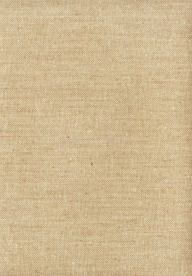 Tessuto crema marrone chiaro ruvido di struttura di Skanirovaniya - tela cerata di tela naturale fotografia stock libera da diritti