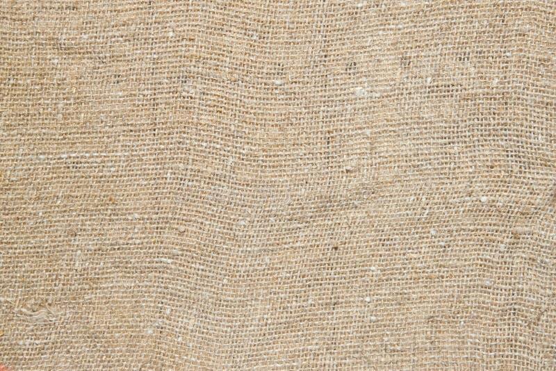 Tessuto della tela di canapa di struttura come priorità bassa immagini stock