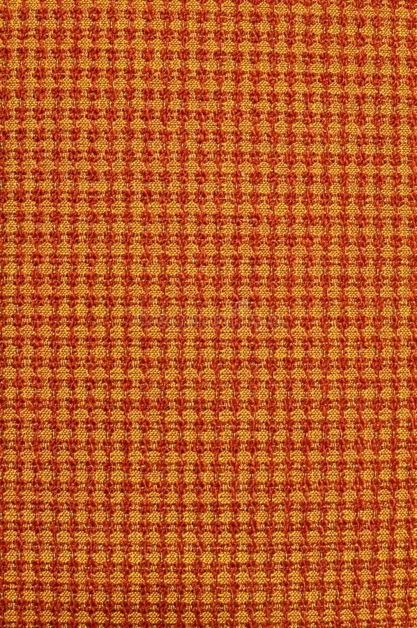 Tessuto di colore giallo arancione immagine stock